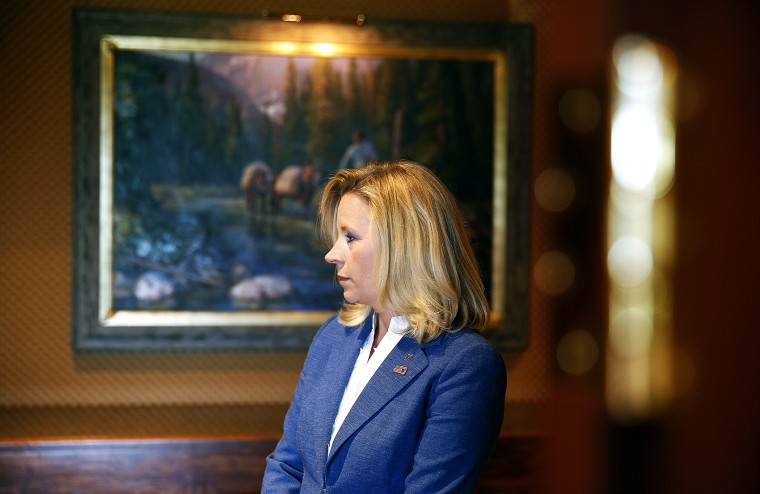 Liz Cheney waits in the hallway for a news conference to begin in Cheyenne, Wyoming, July 17, 2013.