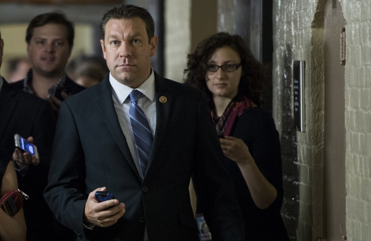Rep. Trey Radel, R-Fla., speaks with reporters as he leaves the House Republican Conference meeting in the basement of the Capitol on Friday, Oct. 4, 2013.