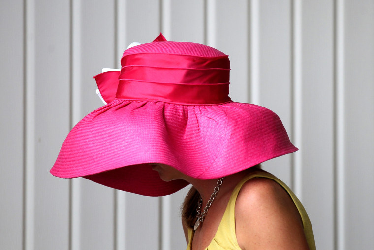 Hats like this one from May 5, 2012 may be popular at the Kentucky Derby at Churchill Downs, but all hat and no cattle may make it difficult for Mitch McConnell to win the votes of Kentucky women.