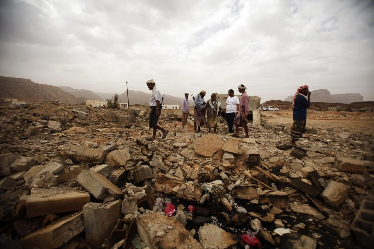 Tribesmen stand on the rubble of a building destroyed by a U.S. drone strike that killed Abdulrahman al-Awlaki, the son of slain U.S.-born cleric Anwar al-Awlaki.