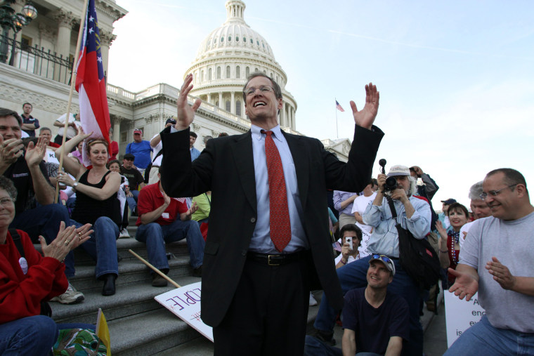 Rep. Jack Kingston, R-Ga., speaks to people demonstrating against the health care bill on the U.S. Capitol steps a day before Congress is set to vote on health care reform on Saturday, March 20, 2010 on Capitol Hill in Washington.
