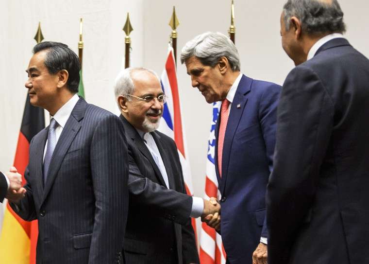 Iranian Foreign Minister Mohammad Javad Zarif shakes hands with US Secretary of State John Kerry, Nov. 24, 2013.