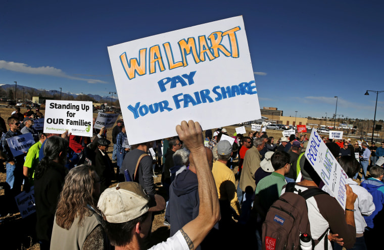 Colorado Walmart employees and supporters join nationwide protests, in front of a Walmart store in Lakewood, Colo. on Nov. 29, 2013.