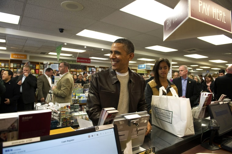 President Barack Obama shops with daughter Malia at Politics and Prose Bookstore and Coffeehouse in Washington, D.C. on Nov. 30, 2013.