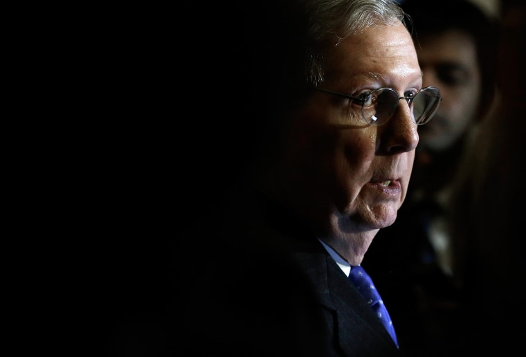 Senate Minority Leader Mitch McConnell (R-KY) speaks to reporters following the weekly policy lunch of the Republican caucus on Nov. 19, 2013 in Washington, D.C.