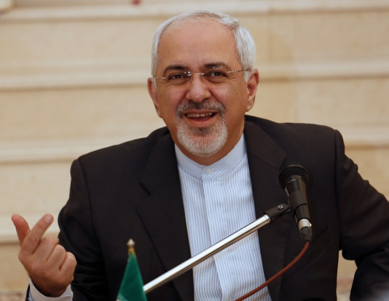 Iranian Foreign Minister Mohammed Javad Zarif  holds a press conference at the Iranian embassy in Muscat following meetings with Omani officials on December 2, 2013.
