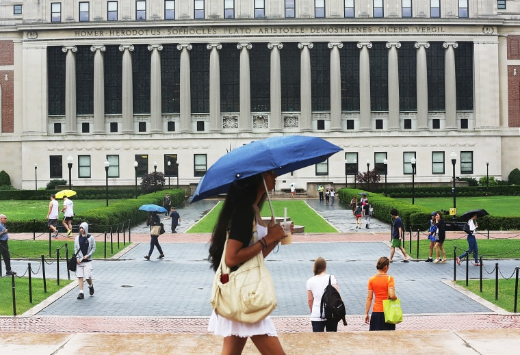 People walk through the Columbia University campus on July 1, 2013.