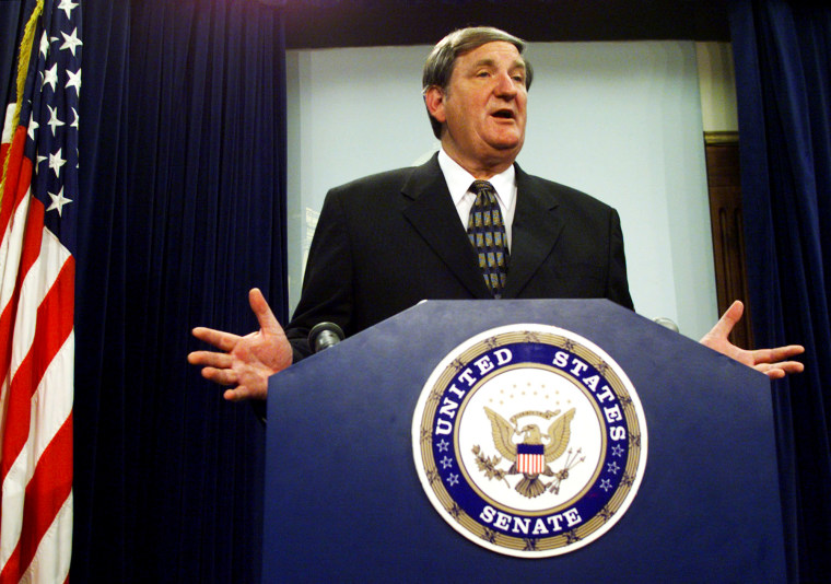 Senator Bob Smith talks to reporters in the U.S. Capitol, July 13, 1999.