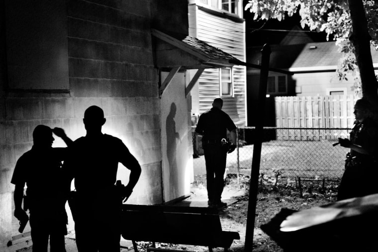 Police officers search for a suspect in Rochester, NY, 2012.