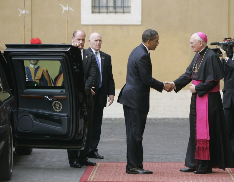 President Barack Obama is welcomed by Bishop James Harvey, at right, as he arrives at the Vatican for a meeting with Pope Benedict XVI, Friday July 10, 2009.