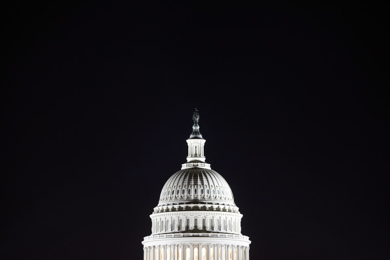 The U.S. Capitol dome in the pre-dawn darkness in Washington D.C.