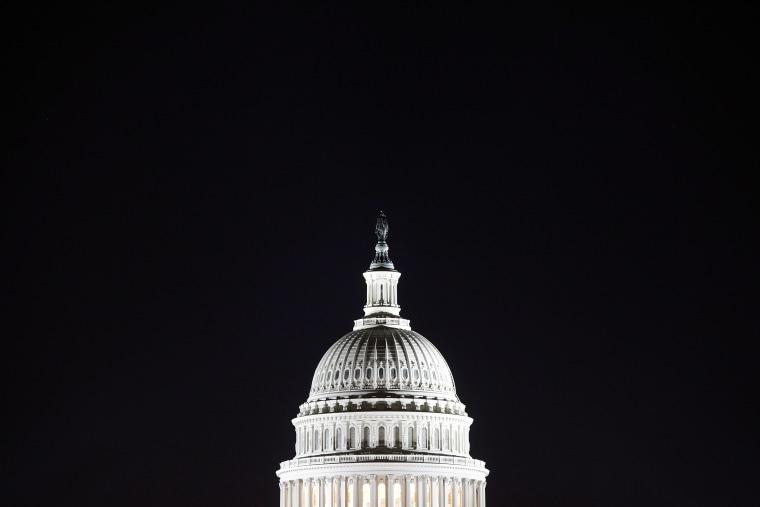 The U.S. Capitol dome in the pre-dawn darkness in Washington D.C.