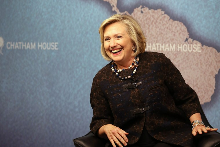 Former US Secretary of State Hillary Clinton smiles as she waits to answer questions from an audience at Chatham House on Oct. 11, 2013 in London, England.