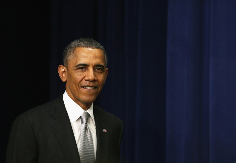 U.S. President Barack Obama arrives for a statement on the Affordable Care Act December 3, 2013 in the South Court Auditorium at the Eisenhower Executive Office Building in Washington, D.C.