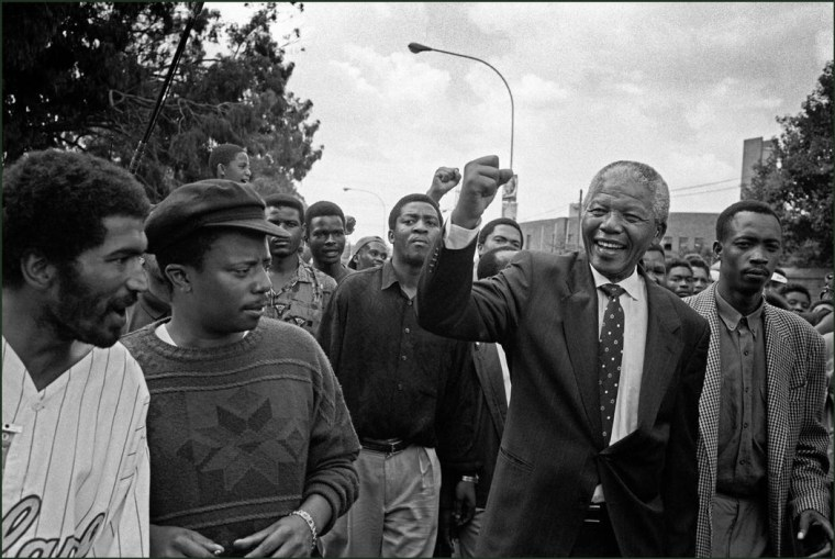 Nelson Mandela surprises locals on an impromptu walkabout in South Africa, 1994.