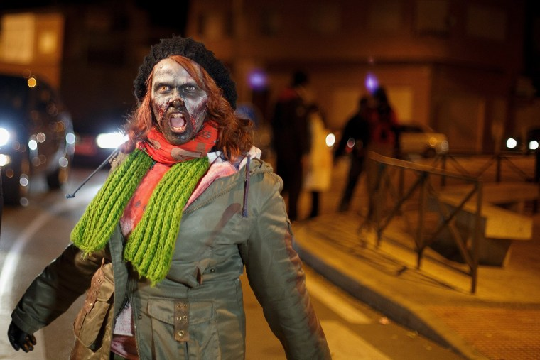 A zombie walks the streets during Zombie Survival contest on December 1, 2013 in Alameda de la Sagra, near Toledo, Spain.