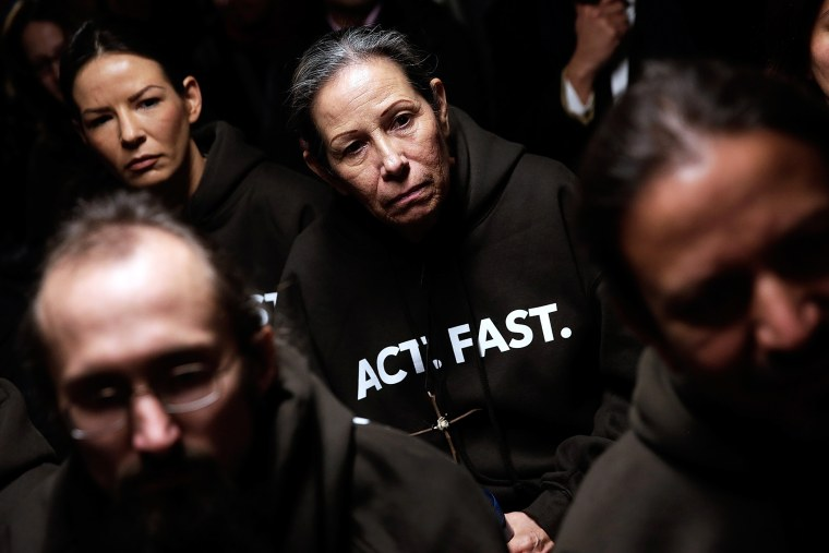 Supporters of immigration reform listen during a Fast for Families press conference in Washington, DC., Nov. 26, 2013.