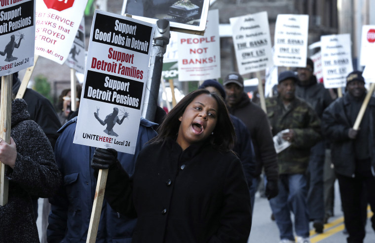 Jalita Shabazz joins protesters during a rally outside The Theodore Levin United States Courthouse in Detroit, Wednesday, Oct. 23, 2013.