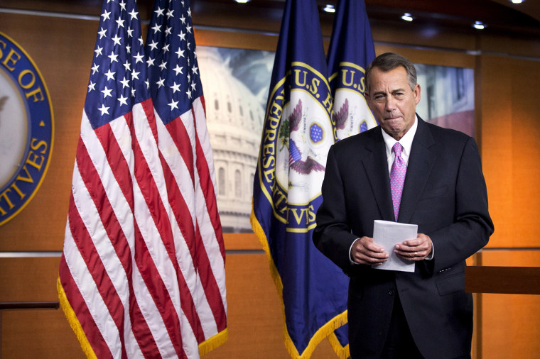 House Speaker John Boehner of Ohio leaves a news conference on Capitol Hill in Washington on Dec. 5, 2013.