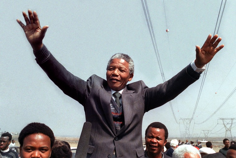Nelson Mandela salutes supporters on Sept. 5, 1990 in Tokoza, South Africa.