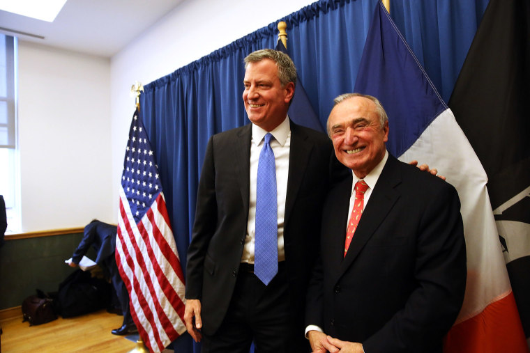 Incoming New York mayor Bill de Blasio stands with Bill Bratton, who has been named to lead the NYPD, Dec. 5, 2013.