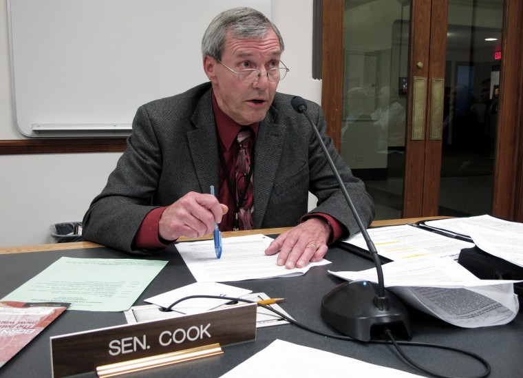 North Dakota state Sen. Dwight Cook, a Republican from Mandan, asks a question during a legislative hearing in Bismarck, N.D. on Nov. 2, 2011.