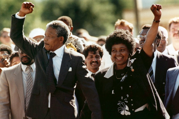 Nelson Mandela and his wife, Winnie, raise clenched fists as they walk hand-in-hand upon his release from prison in Cape Town, South Africa on Feb. 11, 1990.