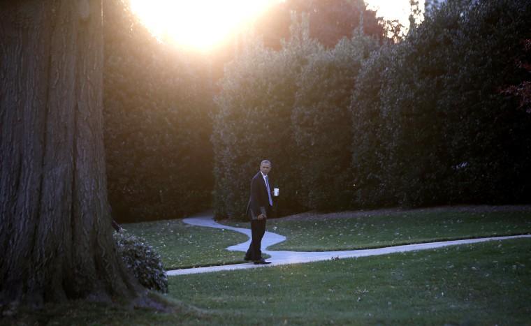 U.S. President Barack Obama walks to the Oval Office of the White House on November 19, 2013.