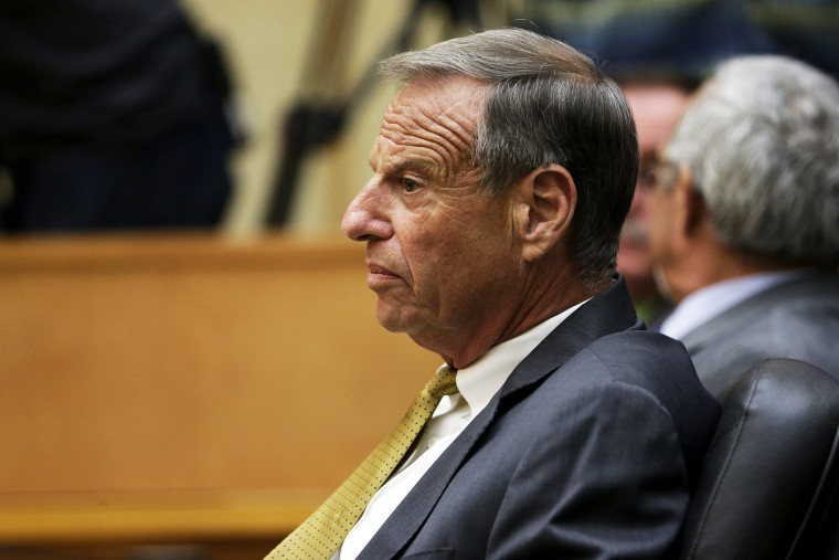 Bob Filner looks on before addressing the city council during a meeting in San Diego, Aug. 23, 2013.