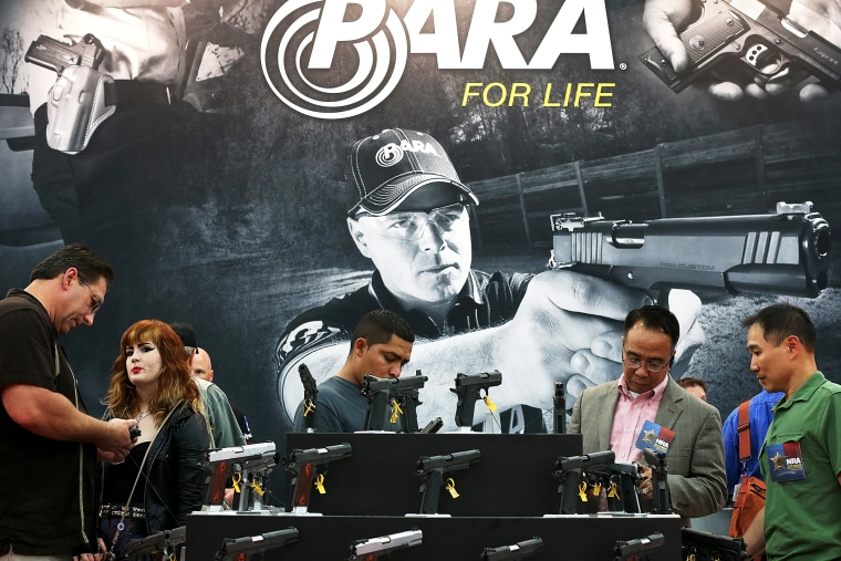 Attendees visit the Para booth at the 2013 NRA Annual Meeting and Exhibits in Houston, Texas, May 5, 2013.