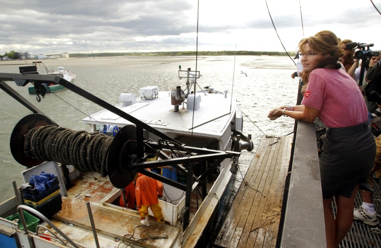 Former Alaska Governor Palin watches a fishing boat unload its catch during a visit to Yankee Seafood Cooperative in Seabrook