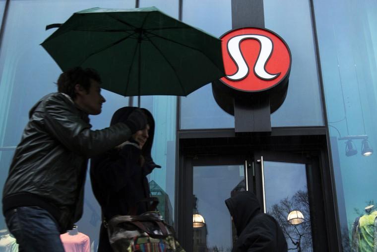 Pedestrians walk past a Lululemon Athletica store in New York, Mar. 19, 2013.