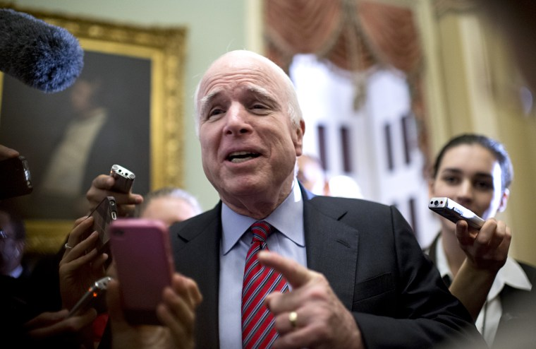 Sen. John McCain, R-Ariz., talks with reporters after a meeting of Senate republicans in the Capitol.