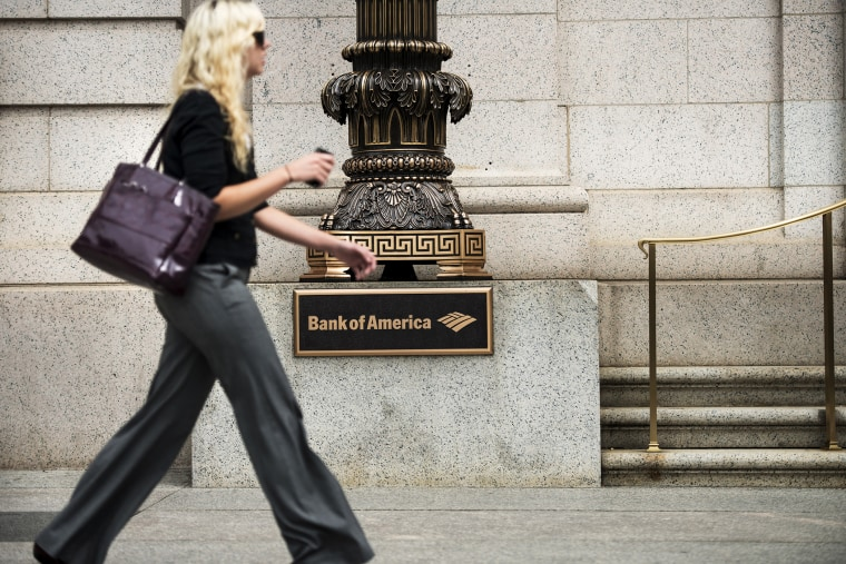A woman walks past a Bank of America in Washington, DC., Aug. 7, 2013.