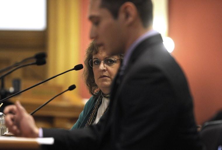 Colorado State Senator Evie Hudak, D-Westminster, left, listens to testimony in the Colorado State Senate in Denver on March 4, 2013.