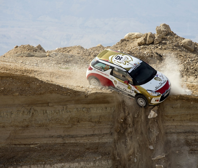 A car veers off a cliff during the first stage of the Jordan Rally in Sweimeh near the Dead Sea on May 10, 2013.