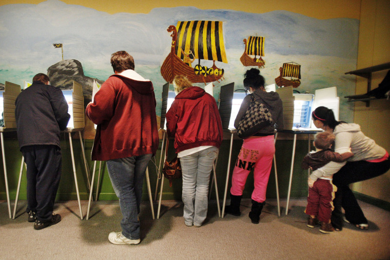 Voters cast their ballots at a polling site in Akron, Ohio, Nov. 6, 2012.