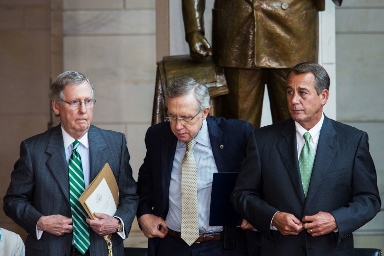 Mitch McConnell, Harry Reid, and John Boehner prepare to take their seats for a dedication ceremony at the U.S. Capitol, June 19, 2013.