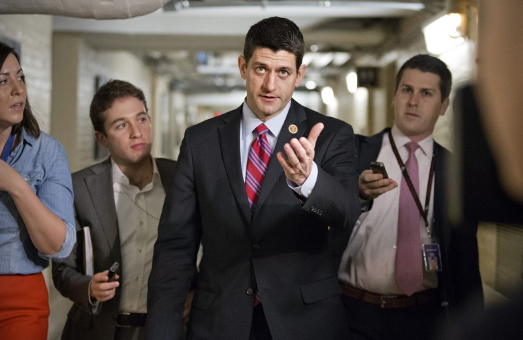 Walking through a basement corridor while talking to reporters about a budget deal Capitol Hill in Washington, Wednesday, Dec. 11, 2013.