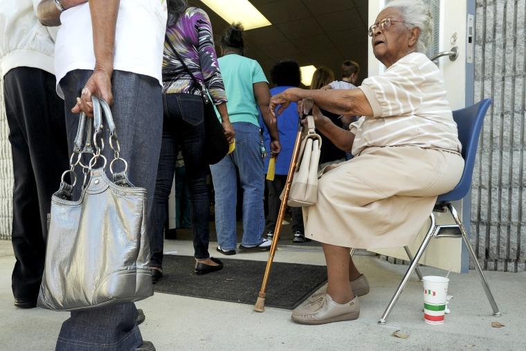 People wait in line to vote in Wilson, North Carolina, October 18, 2012.