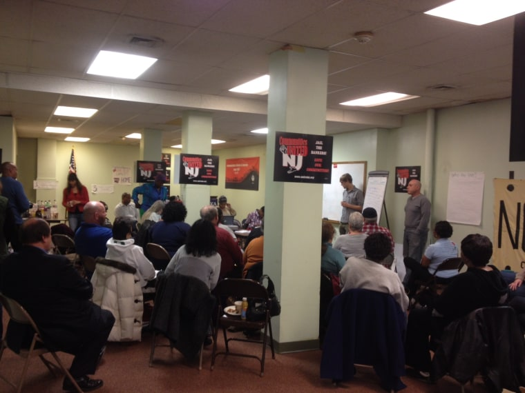 People gather at a Saturday morning meeting hosted by New jersey Communities United in Newark, NJ on December 7, 2013.