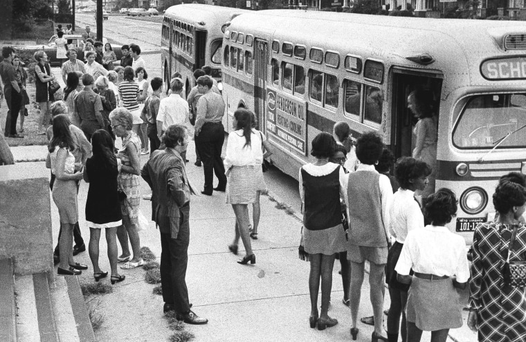 White pupils from outlying areas of Norfolk arrive by bus on Sept. 4, 1970 at inner-city Booker T. Washington High School in Norfolk, VA.