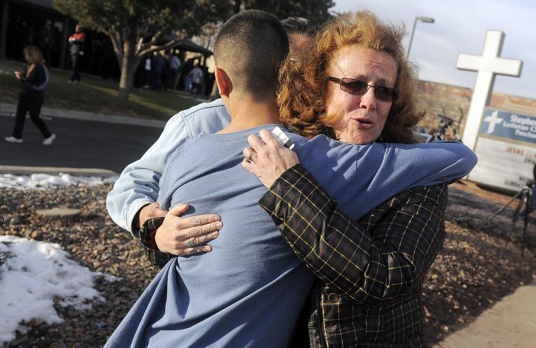 JoAnne Allen, right, hugs her son Alex Allen, 17, after a school shooting on December 13, 2013 at Arapahoe High School in Centennial, Colorado.