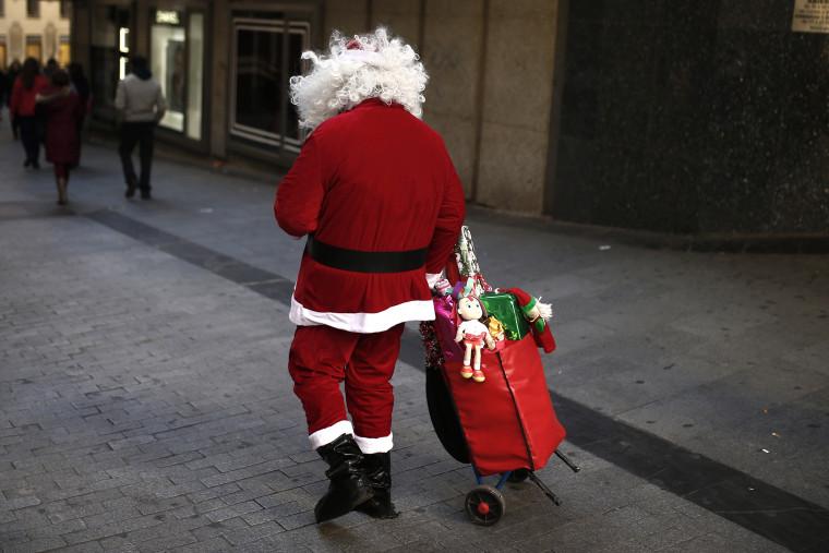 A man dressed as Santa Claus in Madrid, Spain on Dec. 1, 2013.