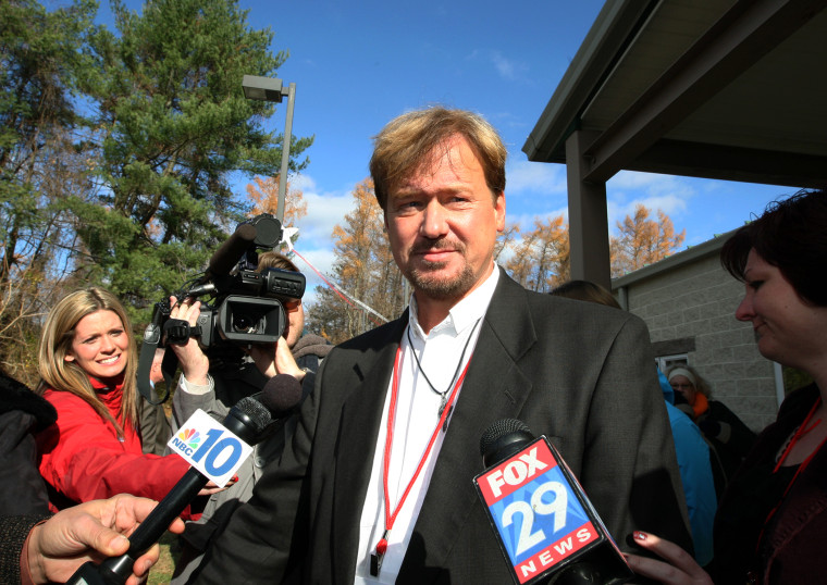 The Rev. Frank Schaefer, center, of Lebanon Pa., is surrounded by the media as he exits the gymnasium for a lunch break from a penalty hearing, at Camp Innabah, a United Methodist retreat, in Spring City Pa., Nov. 19, 2013.