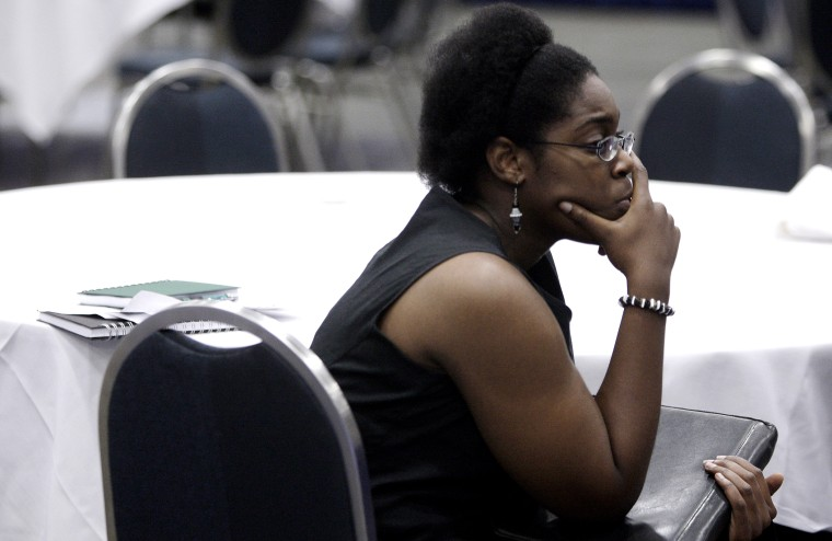U.S. Air Force veteran Brittany Scott waits to talk to corporate recruiters at a job fair targeting unemployed military veterans in Washington, on June 11, 2013.