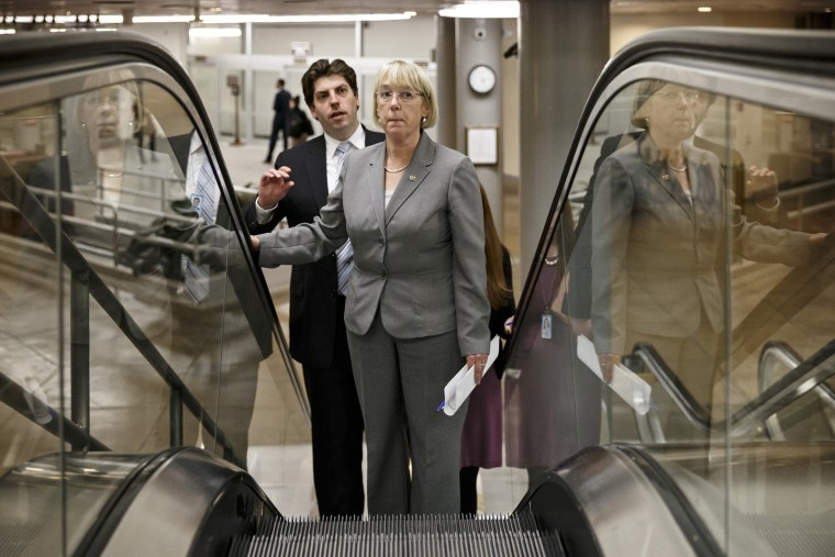 Senate Budget Committee Chairwoman Patty Murray, D-Wash., who negotiated a bipartisan budget compromise with Rep. Paul Ryan, R-Wis., the House Budget Committee chairman, takes an escalator to the Senate for votes on nominations late Dec. 16, 2013, at the