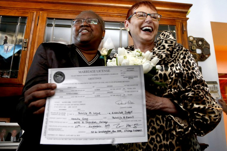 Vernita Gray, left, and Patricia Ewert hold their Illinois marriage license