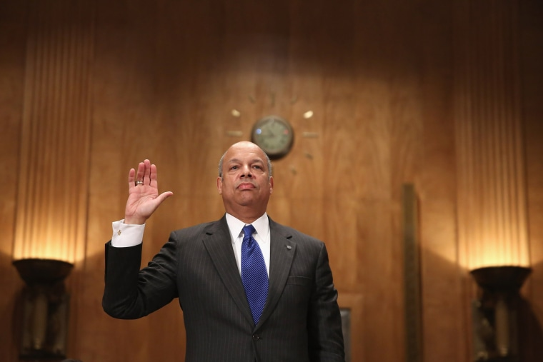 Former Department of Defense General Counsel Jeh Johnson is sworn in before testifying to the Senate Homeland Security and Governmental Affairs Committee during his confirmation hearing to be the next Secretary of Homeland Security in the Dirksen Senate O