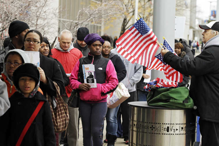 Voters wait in line outside the Cuyahoga County Board of Elections in Cleveland, Ohio on the final day of early voting Nov. 5, 2012.